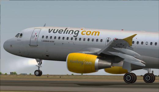 Avión de Vueling despegando.