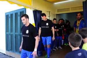 Camisetas negras en señal de duelo (Fotos: deportesmenorca.com)