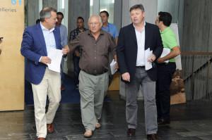 Tadeo, Quintana y Villalonga, dirigiéndose a la presentación del plan.