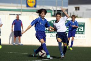 Acción del partido de la categoría alevín (Fotos: deportesmenorca.com)