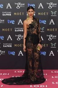 El encaje del vestido de Mariam Bachir permitía entrever unos stilettos de napa metalizada.