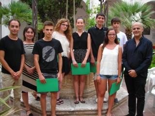2Alumnes del curs de violí amb Corrado Bolsi, Andreu Cardona i Pilar Carreras. Foto Joventuts Musicals de Ciutadella.