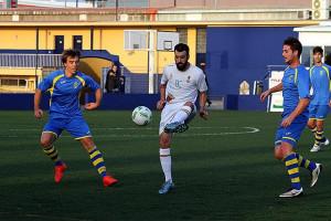 Xavi y Capó, durante el partido.