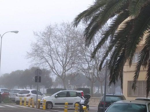 Menorca oculta bajo la niebla
